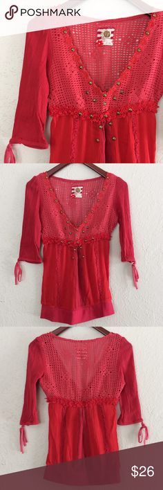 """Unique Free People Top Pink & red Free People top with crochet& embroidered details, metal embellishments, drawstring sleeve """"cuffs"""", 1/2 length sleeves. Elastic empire waist. Top does have stretch. Unique, boho chic piece!  VGUC, no notable flaws  -Sz 4 (fits like a Small) -Bust, 15"""" -Length, 25.5""""  Reasonable offers considered  ❌no offsite transactions/trades Free People Tops"""