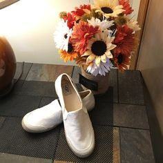 UGG - Linen and Leather Slip On Shoes Beautiful UGG Linen and Leather Slip On Shoes, Worn only once. Excellent Condition. NO Damage or Flaws, shoes no wear, slightly dirty on bottom from wearing them one time. A Perfect Shoe for Spring and Summer!!! UGG Shoes Flats & Loafers