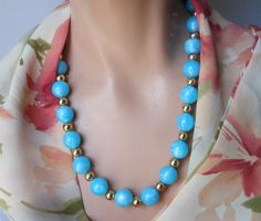 """Use code SOCIAL15 for 15% off all purchases over $15, plus FREE shipping on most jewelry! 1950s blue lucite necklace, blue beads with light blue marbling interspersed with smaller gold beads for a lovely, crisp retro effect  It measures 19 1/2"""" (49.6 cm) without... #etsygifts #vintage #vjse2 #jewelry #gift"""