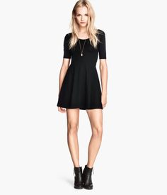 Short-sleeved dress in jersey with lower-cut neckline at back, seam at waist, and circle skirt. | H&M US
