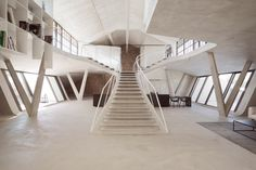Located in Austria, Loft Panzerhalle spans 350 square meters of open space over two floors with smoothed and waxed concrete being the material of choice.