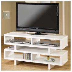 A chic TV console chock full of open storage to display books, DVDs, memorabilia, or just make sure you always know where the remote is. | 31 Stylish Pieces Of Decor You Can Get Right Now With Free Shipping At All Modern