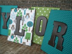 I've been trying to figure out how to hang letters in the kids rooms, I like this idea.  Maybe when Michaels has a big sale on canvases again.