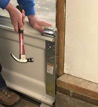 How to Install a Garage Door   HomeTips
