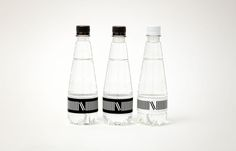 Visual identity and water packaging designed by lg2boutique for Quebec City delicatessen Nourcy