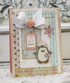 Stamps: Winter Penguin; Cardstock:  Sweet Blush and Vintage Cream; Ink:  Smokey Shadow; Tools: Winter Penguin, Tiny Tags, and Pinking Shears Border die; Accents: Sweet Blush button, Soft Stone Grosgrain; Other Supplies Used: My Mind's Eye paper; Melissa Frances tag and gems; Martha Stewart snow glitter