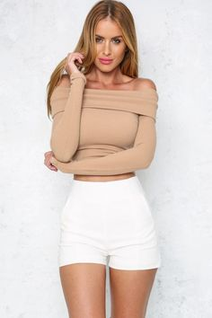 You and your outfit will be looking flawless in the Bronzed Beauty Crop Top! This on-trend style features a folded off-the-shoulder panel with long sleeves. The mid-weight material is ribbed with a soft texture, ensuring you'll be comfortable in cooler weather. For an easy day to night transition, just add black high-waisted black jeans, a statement belt and leather block heels!   Crop Top. Not lined. Cold hand wash only. Model is standard S and is wearing S. True to size. Stretchy fabric…
