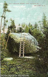 """Rocking Stone near Halifax, NS. Was a popular tourist destination in the 1800s - """"people would climb upon it and spread their lunches, while enjoying the sensation of rocking gently while seated upon the huge rock."""" First extreme sport?  :)"""