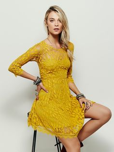 Floral Mesh Lace Dress | Floral embroidered mesh mini dress with lightly pleated skirt. Slip dress is attached underneath and has adjustable straps. Sleeves and neckline are left sheer. Bottom hem is trimmed with scalloped lace.