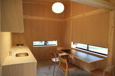 jasper morrison's muji hut in tokyo features cork façades Muji Hut, Hut Images, Tokyo Midtown, Porch Area, Bathroom Images, Morrisons, Building A New Home, Interior Architecture, Jasper