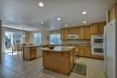 Traditional Kitchen with Kitchen island, Pendant light, Simple Granite, Simple granite counters, limestone tile floors