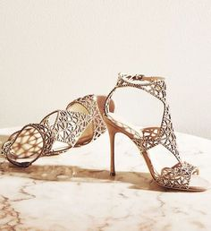 Uniquely glamorous gold wedding shoes;