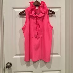 Hot pink ruffled tank! Hot pink ruffled J.Crew tank top. Size small. Button up placket. A timeless style in a funky color- perfect for pretty much any occasion! J. Crew Tops Blouses