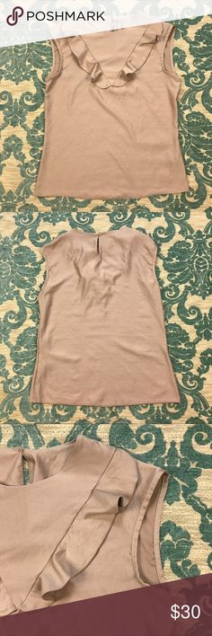 """NWOT Ruffled Trim Sleeveless Top 🌺 Nife Beige Ruffled Trim Sleeveless Top  Size: L  Material: 85% Polyester 15% Rayon  Very Good Condition! No flaws.  Measurements lying flat: Shoulder to Shoulder 18"""", Armpit to Armpit 19"""", Length 22"""".  Please, review pictures. You will get the item shown. Smoke & pet free home. Nife Tops Blouses"""