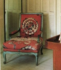 a Louis XV-style chair covered  with an Ivory Coast batik
