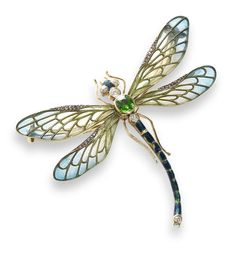 An enamel, demantoid garnet and diamond dragonfly brooch, circa 1900 The thorax set with a cushion-shaped demantoid garnet and two old brilliant-cut diamonds, the eyes with single-cut diamonds, the abdomen decorated with blue enamel and a single old brilliant-cut diamond, between pale green plique-à-jour enamel wings with blue tips and rose-cut diamond highlights, with slightly textured legs and engraved reverse