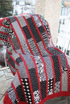 Red, Black, and White Strip quilt from scrapsofthisandthat.blogspot.com
