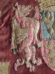 Dragon Supporter Details of a large English flag with embroidered heraldic decorations Circa Tudor period