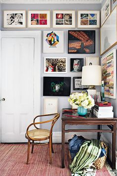 vintage desk styled with colorful art and textiles / sfgirlbybay