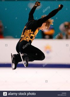 Download this stock image: Alexei Yagudin of Russia jumps in celebration after a near-flawless  performance at the men