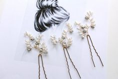 ❀ IMOGENE CRYSTAL & PEARL HAIR PINS ❀  These super cute Imogene bridal hair pins are sure to complement any bride whatever her style! Details: Measures: 5 cm x 5 cm. Pearls: White/Ivory. Wire Options: Silver, Gold or Rose Gold. Available as a set of 3, 5 ( save 10% ) or 7 ( save 15% )  ❀ Similar in Style ❀ Laurel Pin Set https://www.etsy.com/uk/listing/204433299  ~ All of my beautiful bridal accessories are hand-made by me which means that every creation is a...