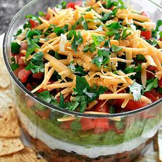 Light Seven Layer Dip...........  It's like a bean burrito in a bowl. And by that, I mean it's like Heaven. I could eat this every day!  .