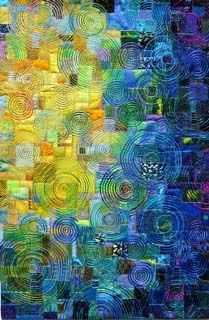 """Crumb quilt made more beautiful by the circular quilting!  Kind of reminds me of my favorite painting """"Starry Night"""""""