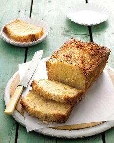 Coconut-Pineapple Loaf Cake Recipe -- Toasted coconut balances the tart sweetness of pineapple and provides a crunchy topping for this buttery cake.