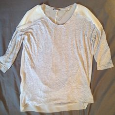 Zara 3/4 sleeve top Sheer, soft and flowy Zara W&B collection top. Worn only a few times. Front is light grey and back is a very sheer ivory. Zara Tops Blouses