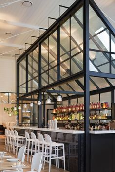 Originally a church built in 1908 and converted to a library in the 1970s. From 2009 to 2011, owner Mario Kalpou worked with interior designers Hecker Guthrie to transform the library into its current incarnation as a restaurant in Cronulla, a suburb of Sydney, Australia.