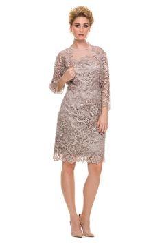 A tasteful cocktail dress that you could wear to an event, or formal occasion. Floral crochet design caresses neckline while a mesh panel continues to form a tasteful scoop. The hem of the gown is qui