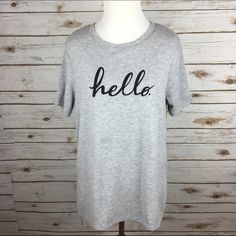 "[Stranded] Hello Graphic Text Tee Casual Chic Cool I can't help but start singing Adele when I see this tee! Super soft warm knit short sleeve tee. Longer length. Side vents with step hem. Relaxed fit.  Color: Gray Fabric: 64% Polyester 33% Rayon 3% Spandex Size: Small Bust: 18"" Length: 25"" in front 28"" in back Condition: EUC. No flaws.  No Trades! Stranded Tops Tees - Short Sleeve"