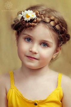 Beautiful child with braided hair and flowers
