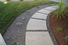 Another genius idea from our designer: cut channels into the existing concrete path and lay pea gravel between and around the path. Add some succulents and voila!