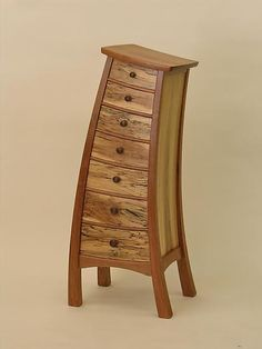 whimsical shaped solid cherry, maple & cedar dresser ~ 'tip-top semainier' ~ steven m. white ~ very much a dr. seuss type of fun! ~ described as 'self cleaning top' HA!