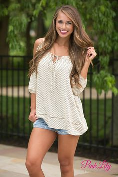 You're going to love wearing this flowy blouse all summer long! Featuring a simple beige and black diamond print, it also features trendy open sleeves, a v-cutout at the bust, and a cute fabric tie in front!