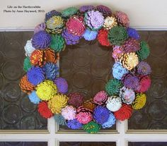 "Didn't do much stamping this week. Instead, I worked on creating this ""zinnia"" pine cone wreath. It is currently hanging on my front door, and I love it! This project began earlier this summer when I saw an idea on..."