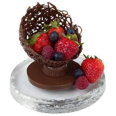 Add a continental touch to your dessert table with a candy filigree creation brimming with fresh fruit. Filigree shell is made with Mini Ball Pan and base with made with Peanut Butter Cups Mold and Circle Cookie Cutter. All formed with Light Cocoa Candy Melts?. Fill with the freshest fruit of the season.