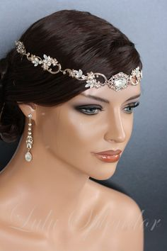 This is a fabulous new Bridal Headpiece thats hand made and exclusively designed for glamourous wedding wear. This Wedding Forehead band is made with really stylish vintage stampings and accented with sparkling Swarovski Crystal Rhinestone. Its just lovely. I have made this one quite long so it wraps around your head long enough to be tucked into your hairstyle for a seamless look. You can also wear it headband style too. The ends have combs soldered on for attachment. All the pieces are…