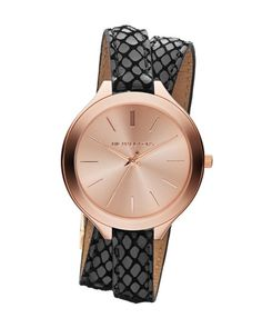 A rose gold face watch with python-embossed black leather double straps by Michael Kors. Fresh off Kors' Spring 2014 runway, this watch stands out from the rest of Kors' standard chunky timepieces. Slim Michael Kors Runway Watch, $160