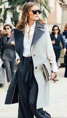 Black wool pants, white top, pale gray oversized jacket