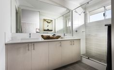 Stunning ensuite with Caesarstone benchtops, dual semi-inset vanity basins and double shower