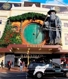 "(AP photo/Nick Perry). People walk by the Embassy Theater where a giant statue of the character Gandalf from the upcoming movie ""The Hobbit: An Unexpected Journey"" overlooks the passersby in Wellington, New Zealand, Monday, Nov. 19, 2012."