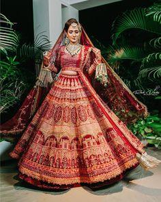 We can't get over how beautiful this designer bridal lehenga looks on this bride! Indian Bridal Outfits, Indian Bridal Fashion, Indian Bridal Wear, Indian Designer Outfits, Bridal Dresses, Indian Wedding Dresses, Bride Indian, Indian Lehenga, Indian Wedding Lehenga