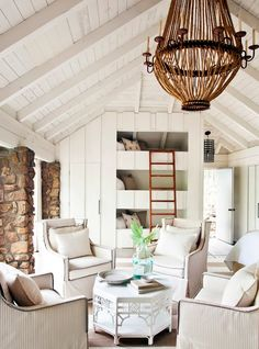#White paneled, light filled great room. #bunk beds, #rope #chandelier