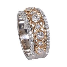 8K white and rose gold band ring with a rose gold center row bead set with nine round, brilliant-cut diamonds.