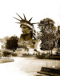 Head of Statue of Liberty on display in park in Paris, shortly before the ITS destination to New York.