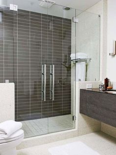 Glass double-door shower, brown tile