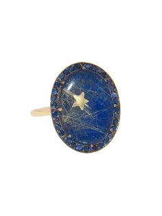 Andrea Fohrman oval lapis lazuli and rutilated quartz ring with blue sapphires, from the Celestial collection. Available at ylang23.com.