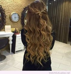 Chic braided half up half down with big loose curls